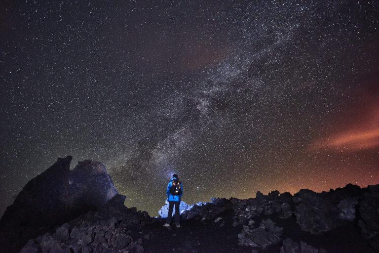 Astrophotography on La Palma light painting a man
