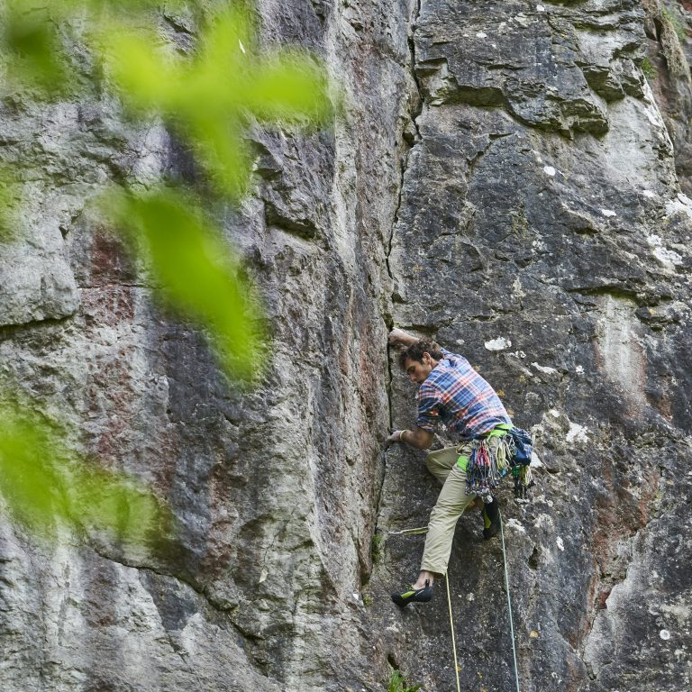 Robbie Phillips rock climbing in the Peak District