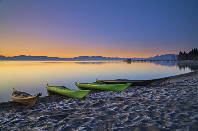 Matt Ray adventure writer and photographer takes a pre-dawn photo of kayaks by Lake Tahoe