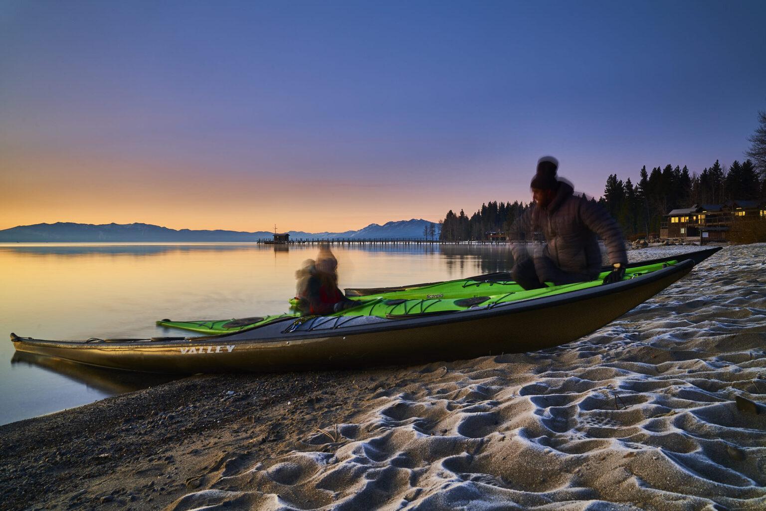 Launching kayaks into Lake Tahoe at dawn