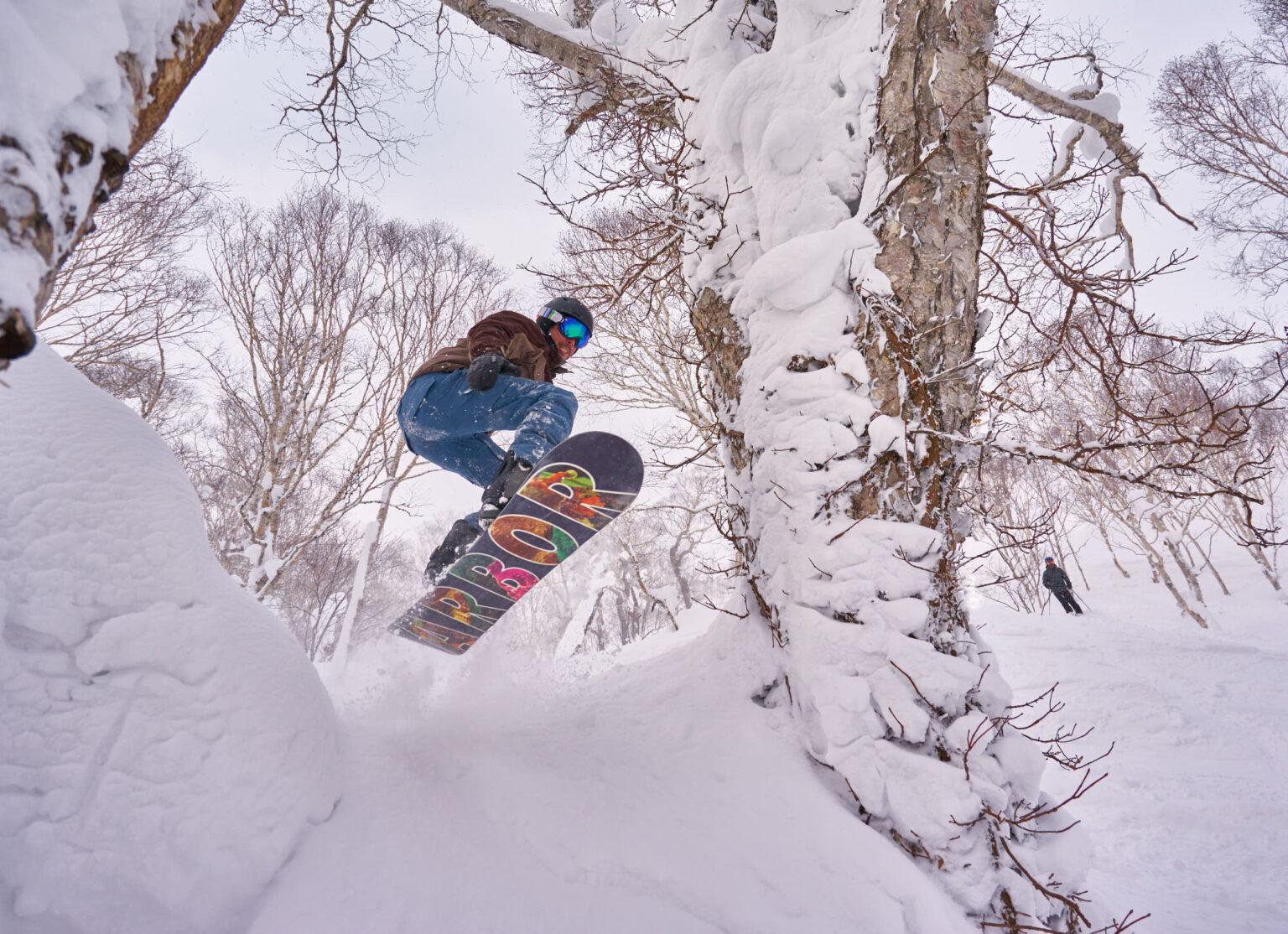 Erie flying through the trees at Rotsuko powder snow line