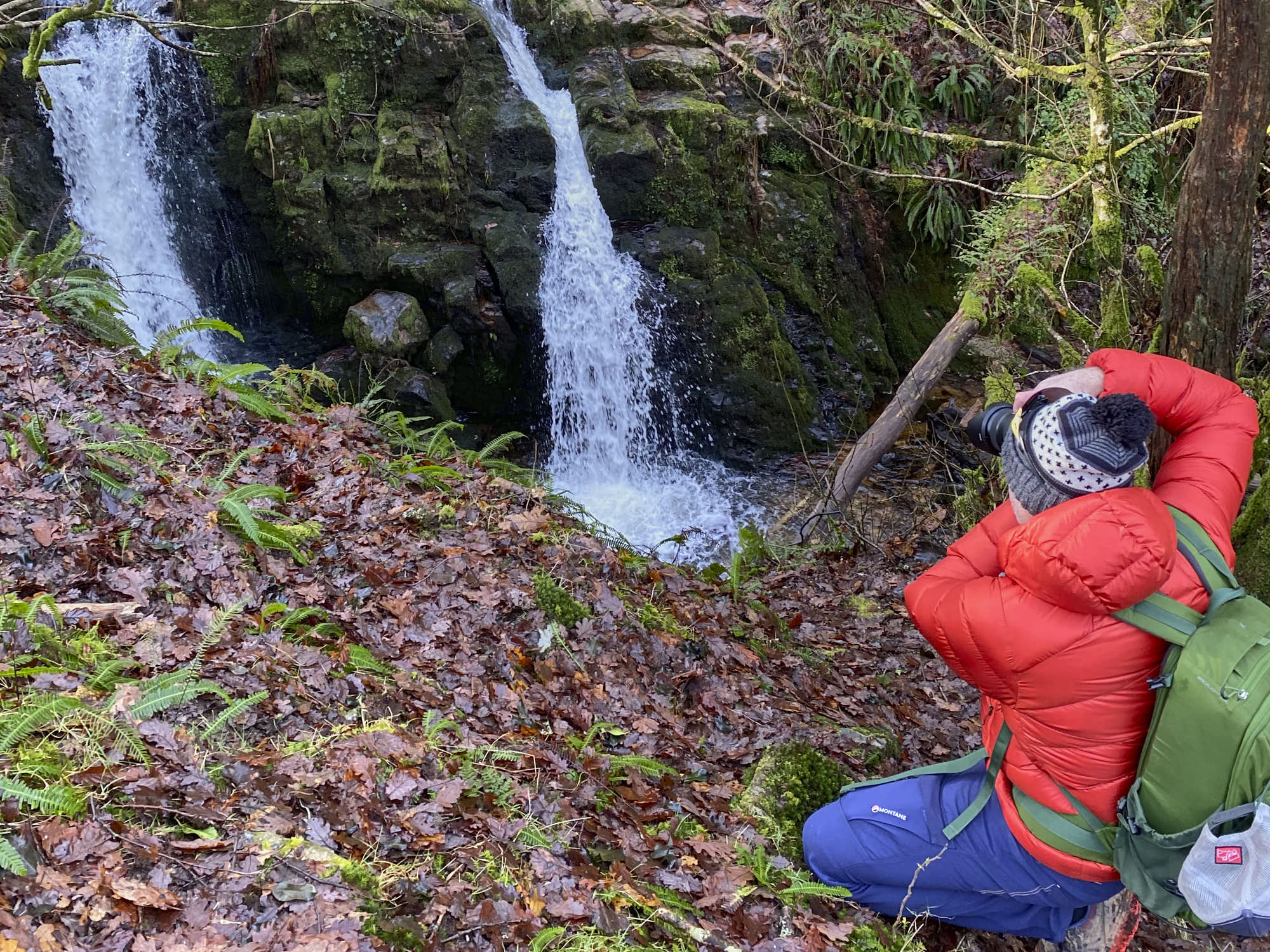 Matt gets into position to shoot Venford Falls wearing the Patagonia Fitz Roy Down Hoodie