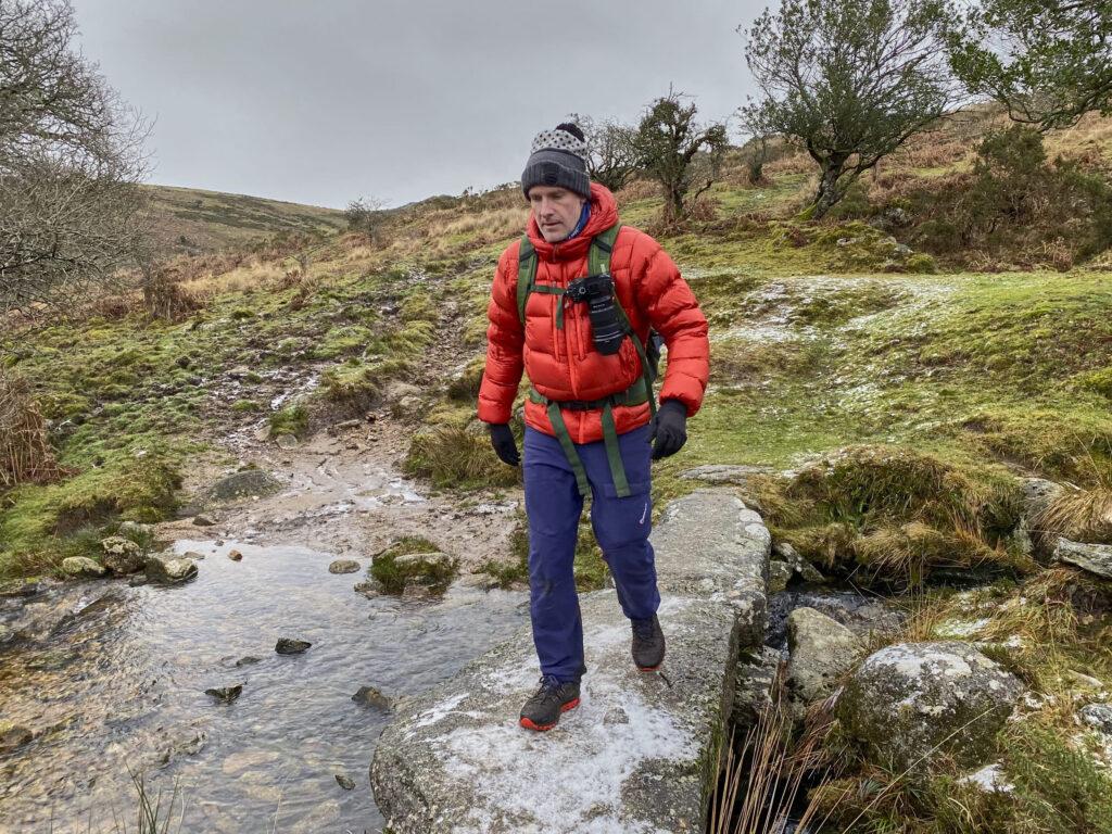 Matt crosses a Dartmoor stream in the Patagonia Fitz Roy Down