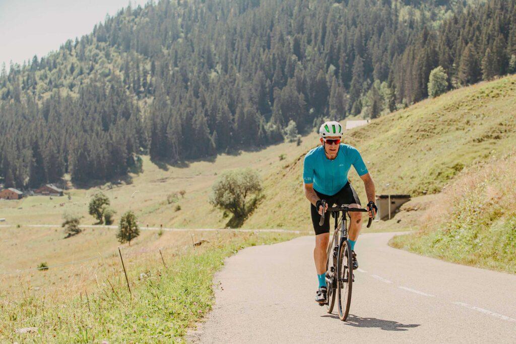 Matt Ray riding up to the top of Col de La Ramaz, French Alps