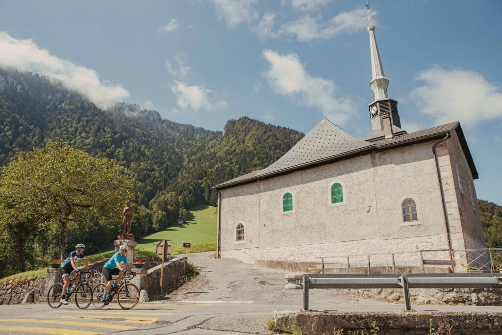 Riding past the church at La Vernaz in the French Alps