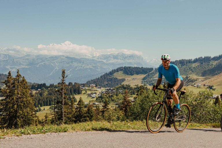 Matt Ray riding in the Alps with Mont Blanc in the background