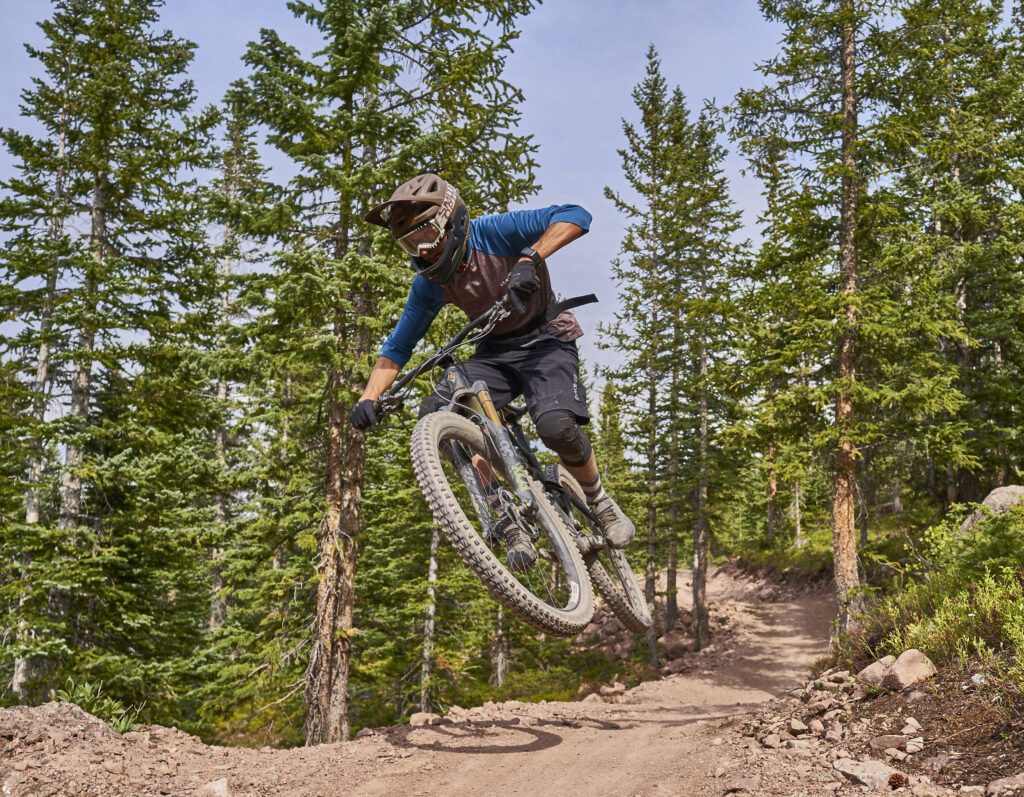 Getting some air after a fast take off at Snowmass Bike Park