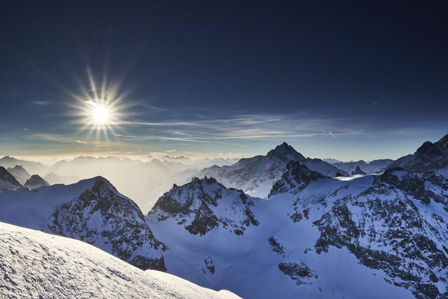 The sun rising over the Austrian Alps